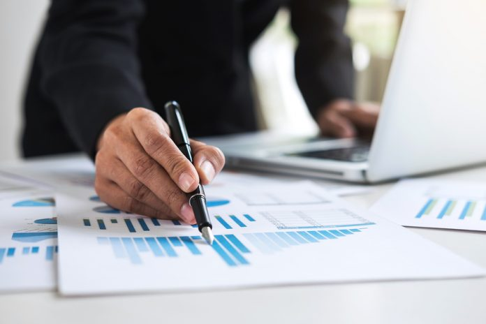 stock image of finance person working hard, tax, sales tax,
