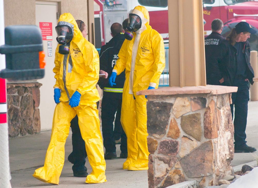 Emergency workers walk in protective suits at St. John's Health in Jackson as they rehearse a response to a potential COVID-19 report. (Angus M. Thuermer, Jr./WyoFile)