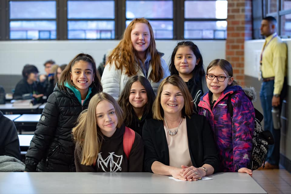 First Lady Jennie Gordon surrounded by smiles as she pauses for a pic during National School Breakfast Week, March 2-6. (H/t @firstladywyoming)