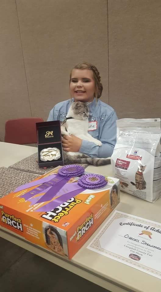 Acord with her cat, Golden, who passed away in an accident earlier this week. Together, they won overall showman at the cat show last year.