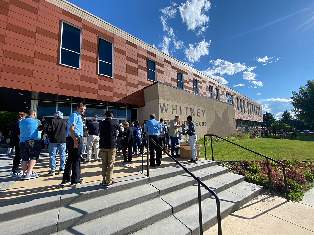 Many Gillette Pronghorn fans, coaches, students and athletes wait outside of Whitney Hall at Sheridan College to attend and speak at the NWCCD Board of Trustees meeting Wednesday evening.