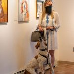 Blanche Guernsey, artist, poses by her artwork that was inspired by her dog, Leo.