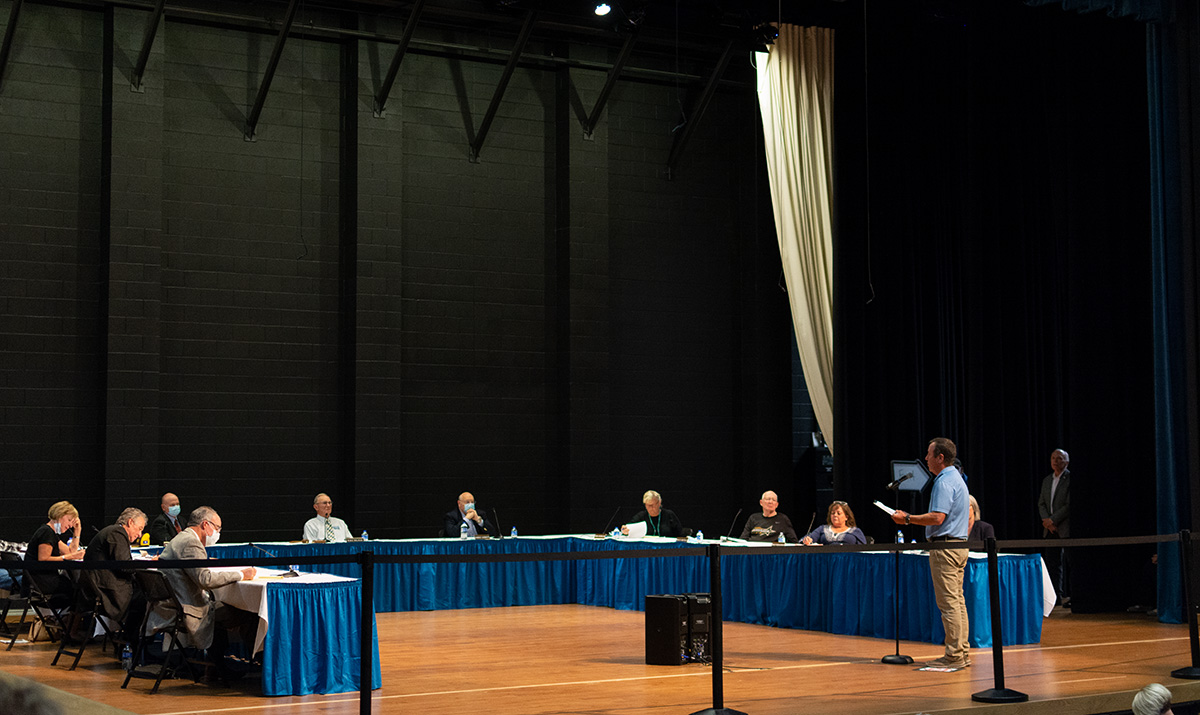 A Gillette Pronghorn's fan addresses the Board of Trustees on Wednesday evening at the Sheridan College in regards to the proposed budget cuts.