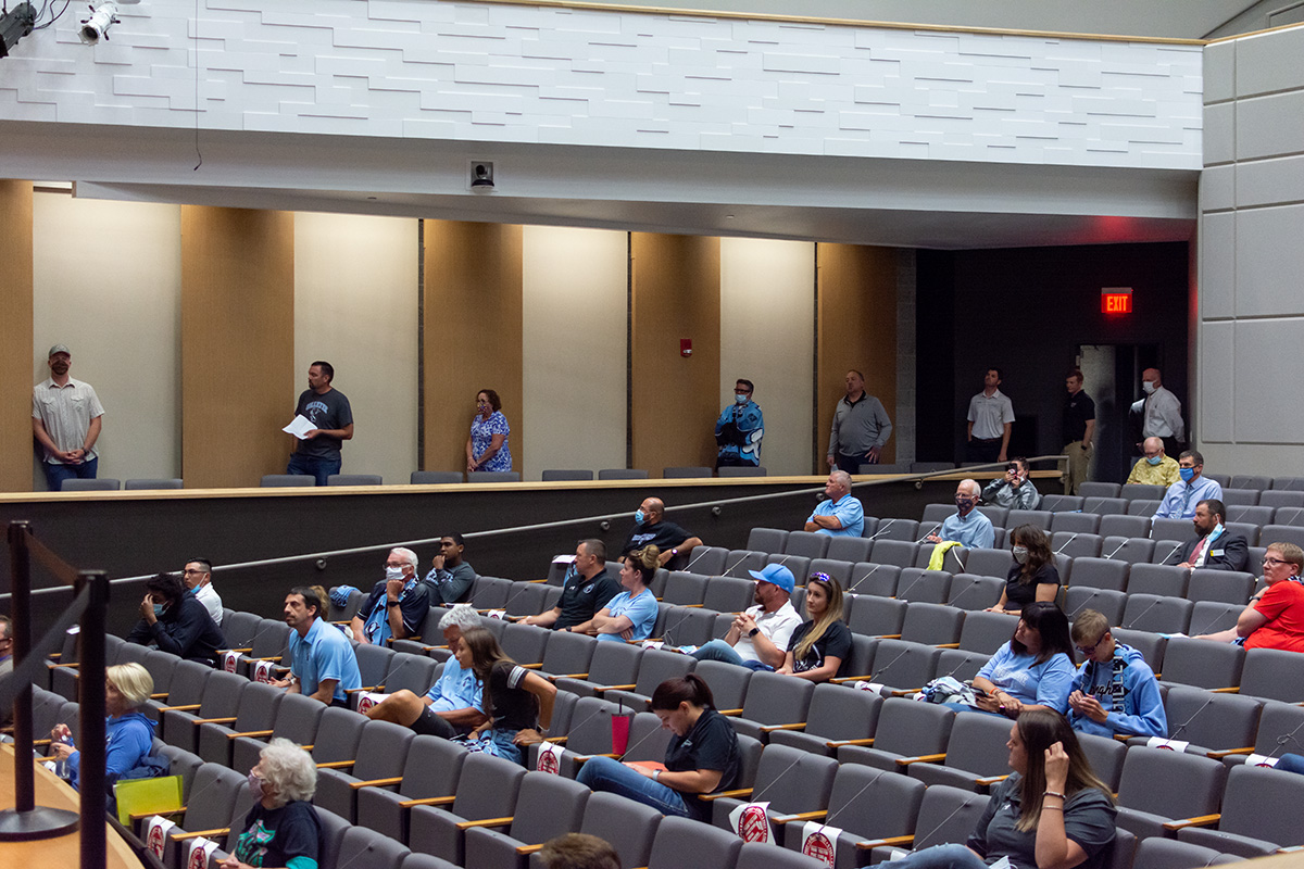 A shot of the audience at a line of community members awaiting their chance to speak to the Board of Trustees at Wednesday evenings meeting.