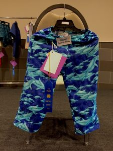 Husdon's blue lounge pants with dolphins on them.