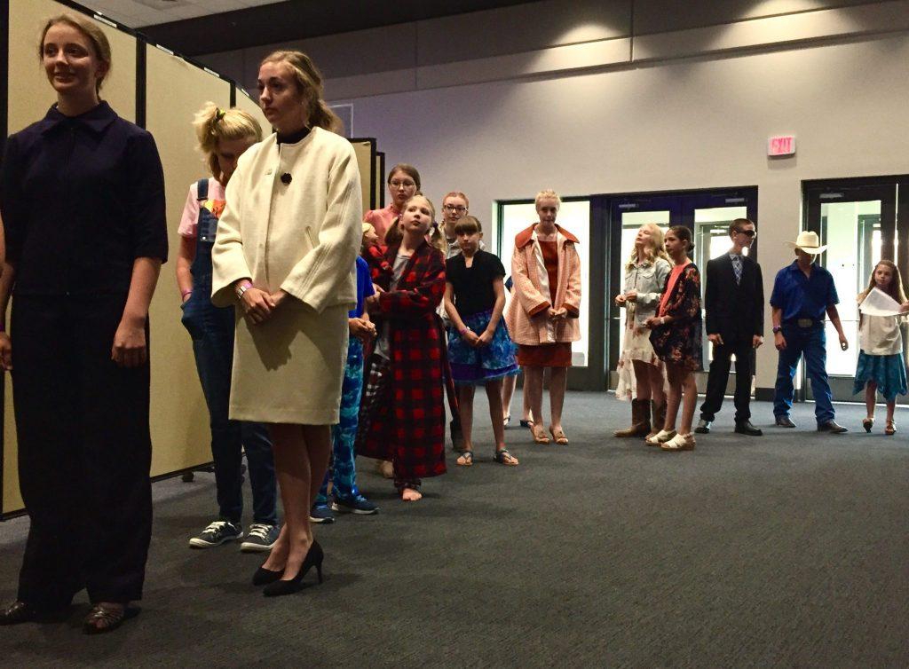 Competitors in the CCF Fabric and Fashion division line before taking to the stage to show off the outfits they either sewed themselves or bought for fair.