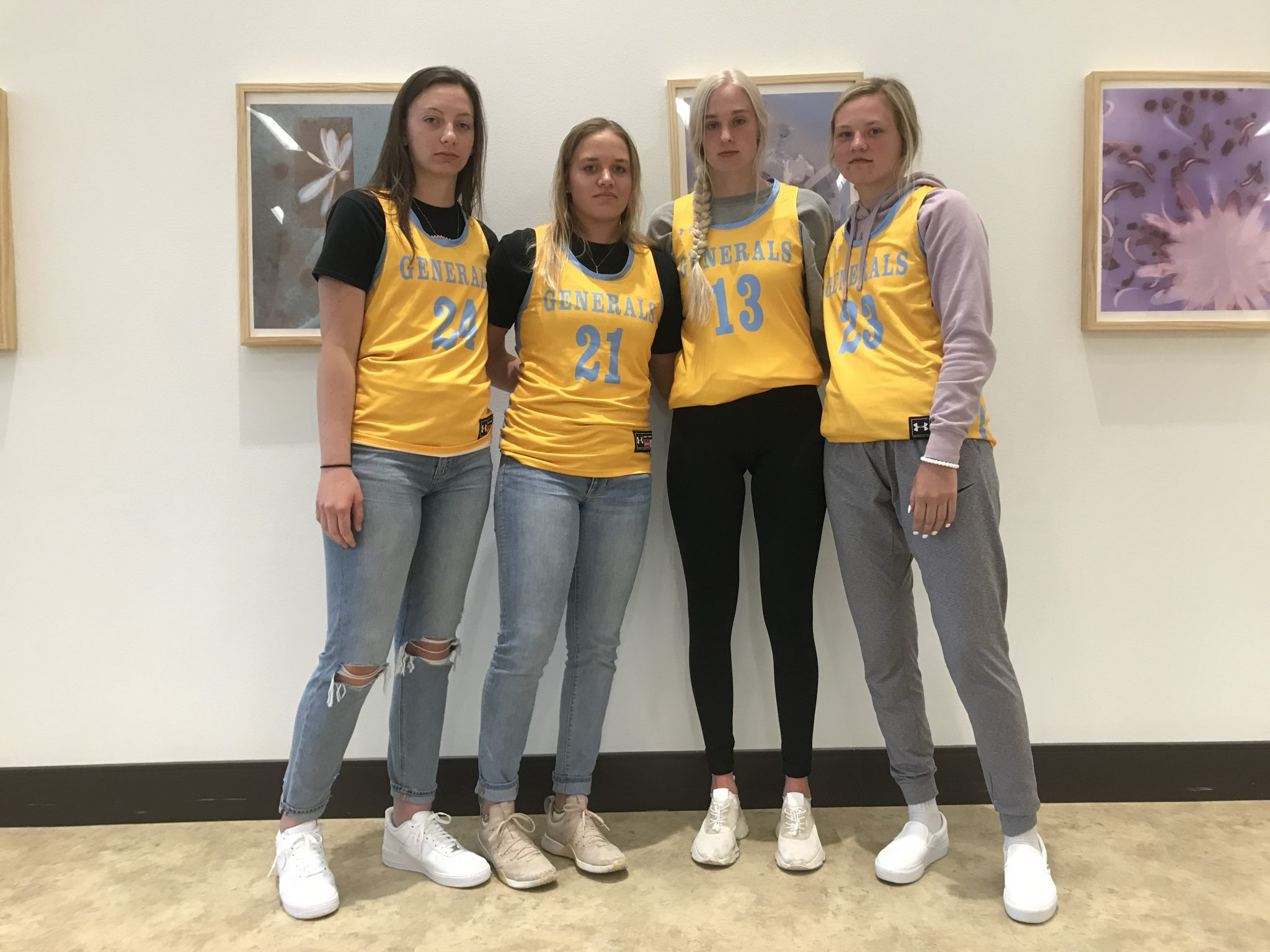 Recently recruited Women Wangers Basketball players prepare for public comment