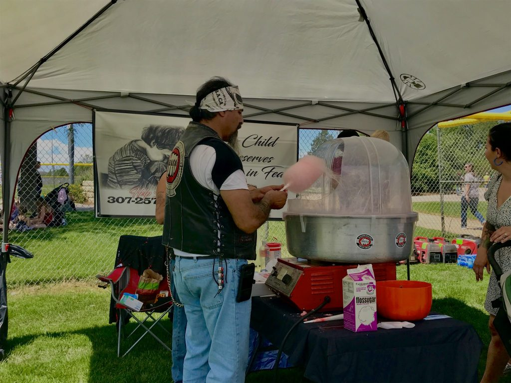 Biker with B.A.C.A makes cotton candy during the 4th of July Hotdog feed at Bicentennial Park.