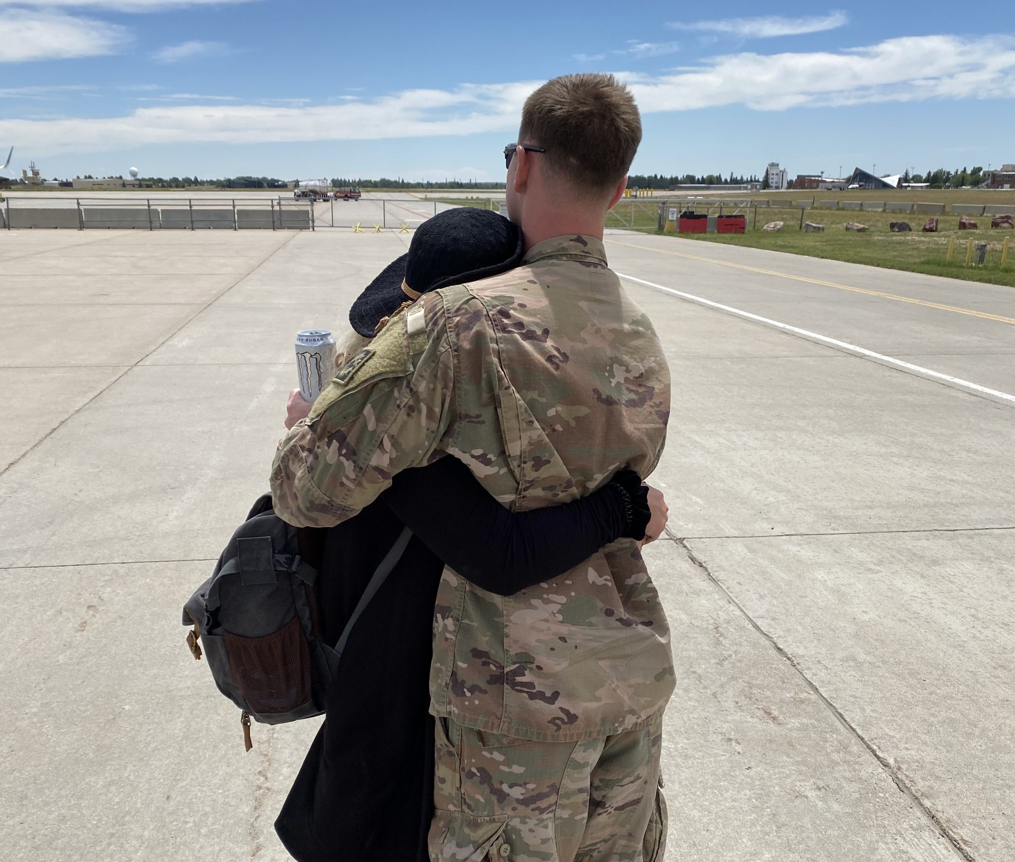 Cpl. Grant Byelich and his sister, Brooke Byelich, embrace following his return from deployment.