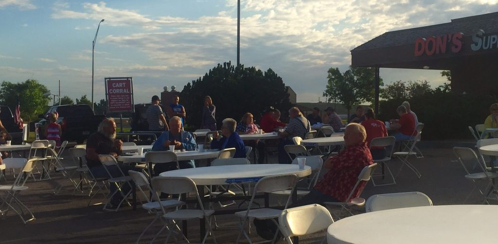 Friends and family members gather at Don's Supermarket on the 4th of July for the annual Pancake breakfast.
