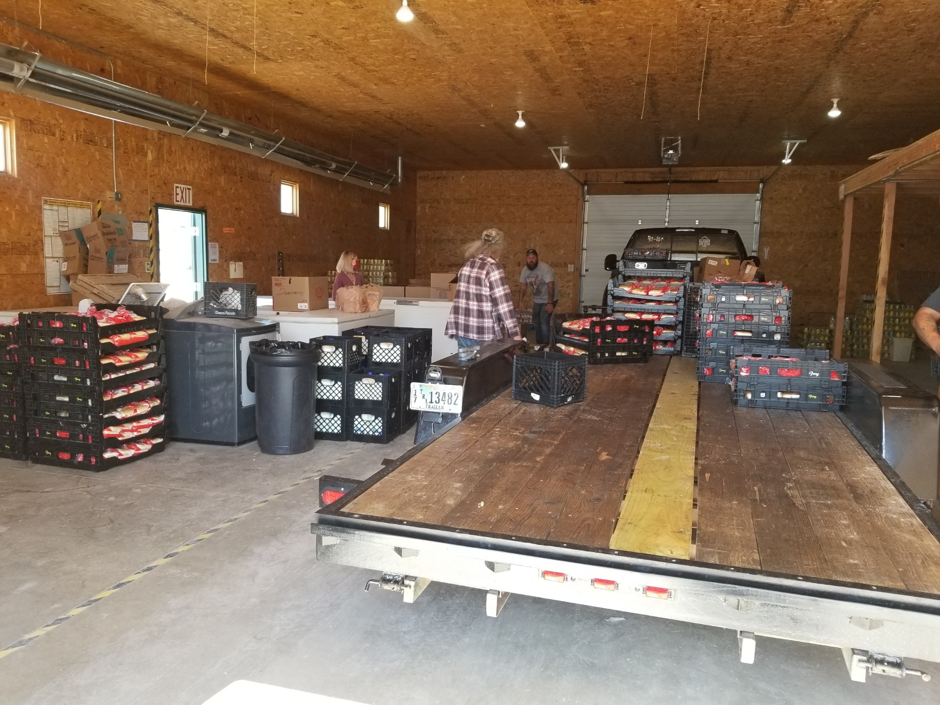 Volunteers from Gillette's Save the 4th Of July Group unload trailer of left over food from their celebration.