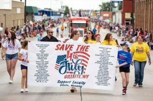 Shelby Bachtold walks with the rest of the 307 Patriots during the 4th of July parade.
