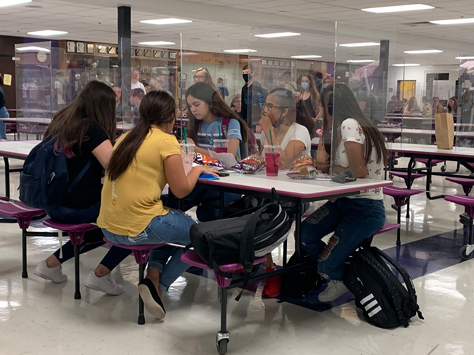 CCHS students utilize the newly implemented screens during lunch.