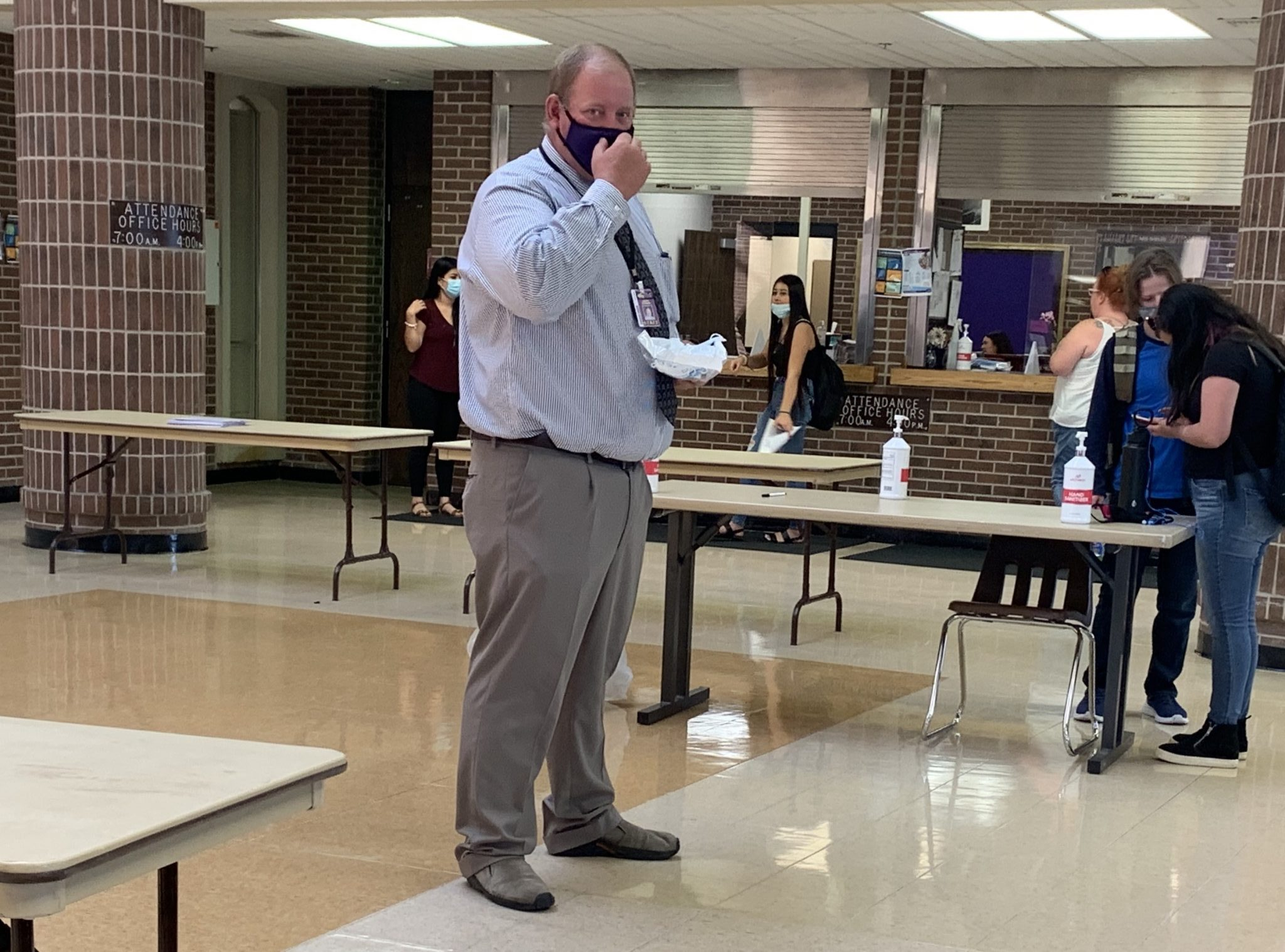 CCHS Principal Jason Garman waits for students to return from lunch, hoping they may need a mask.