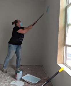 Valerie Borchgrevink rolls on the first coat of paint in Meade's bedroom.