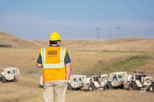 Wade (Last name) overlooks the four geophysical survey vehicles as they drive along their route.