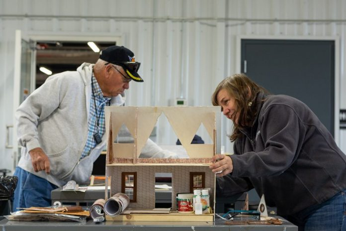 """Duane """"Swede"""" Erickson and daughter Leann are in a rush to the finish line as they complete the first of two dollhouses by Christmas."""