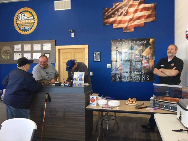 The staff at Octane Garage and Record Supply NAPA celebrate Veterans Day with free oil changes and lunch for veterans and first responders.