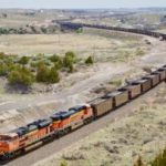 An empty BNSF Railway coal train leaves Guernsey and heads north on May 12. Coal shipments coming down from the Powder River Basin are a key part of this rural town's economy and a source of good paying, union jobs. BNSF announced it would pull 87 jobs out of Guernsey as coal's decline threatens the regional economy. (Andrew Graham/WyoFile)