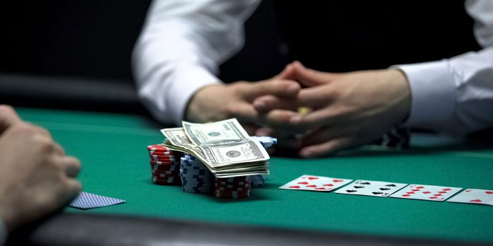 Stock Image of Risky Poker Player Going All In