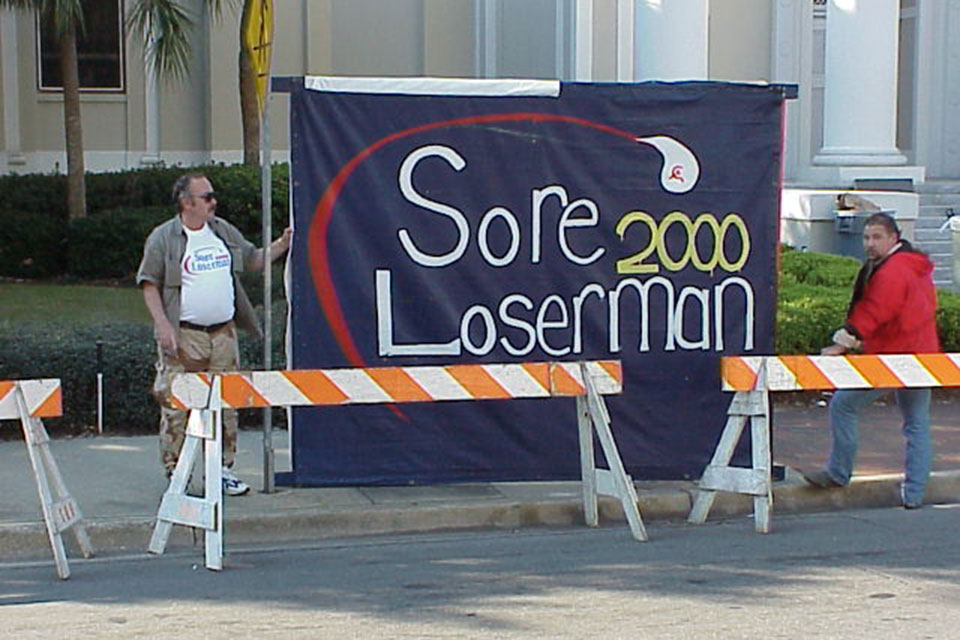 As the Florida recount drug on, some protesters coined the phrase Sore Loserman because of its sounding similar to Gore Lieberman. (Photo courtesy of Village Square/Flickr, Creative Commons)