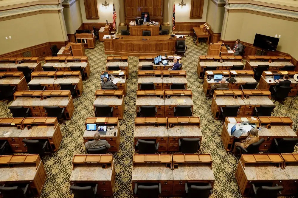 The House chamber, crowded with representatives during normal legislative sessions, was nearly empty as lawmakers kept their distance and spread throughout the Capitol during the May 15-16, 2020 special session (Photo Courtesy Andrew Graham/WyoFile).