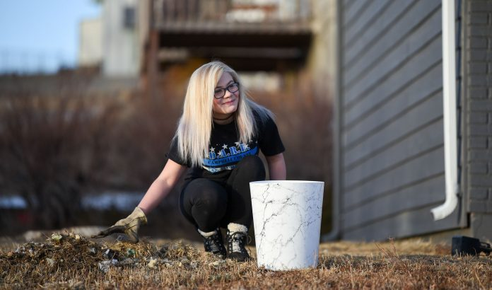 Calli Schill, 11, was all smiles while doing yard work. (Photo: County 17/Brooke Byelich)