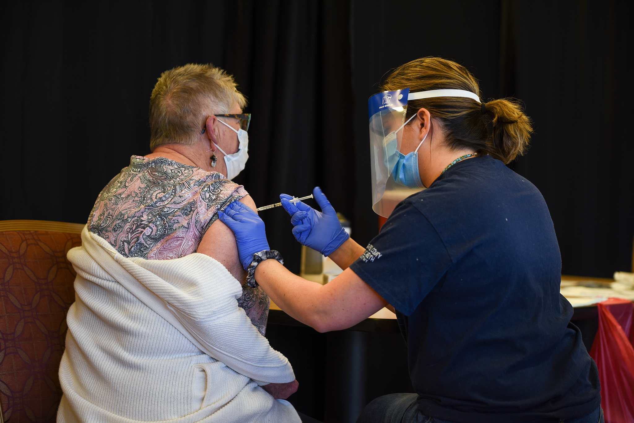 Helen Harper receives the Moderna COVID-19 vaccination, administered by Campbell County Public Health nurse, Sophie Hood. (Photo: County 17/Brooke Byelich)