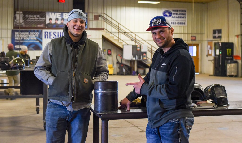 """Jake Ford, 18, and Tyler Sasse stand next to a welded pipe that is claimed to be """"nuclear quality"""" (Photo: County 17/Brooke Byelich)"""