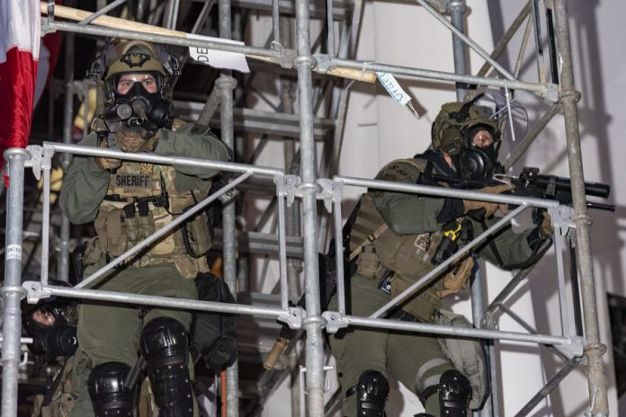 Law enforcement officers at the U.S. Capitol on Jan. 6, 2021 attempt to regain control of the building (Photo: Blink O'fanaye/Flickr, Creative Commons).